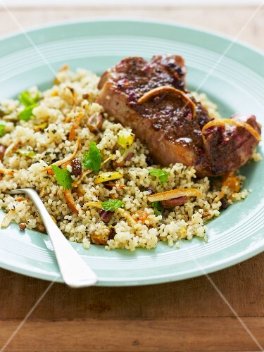 Pilau rice with pork chops, orange zest and pistachio nuts