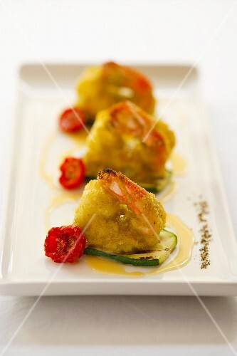Battered king prawns with cherry tomatoes