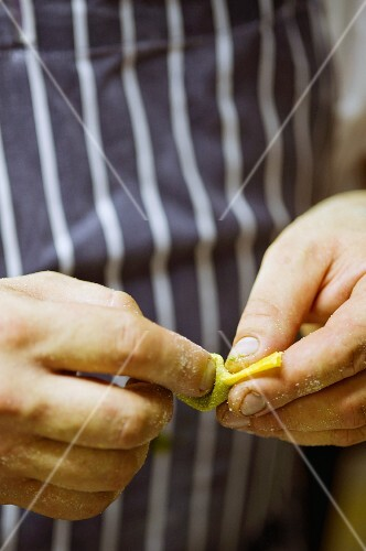Hands shaping tortelloni