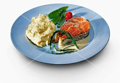Salmon steak with mashed potatoes and vegetables