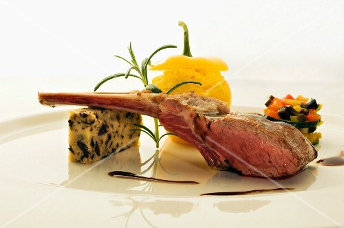 Saddle of lamb with pepper polenta and olive bread