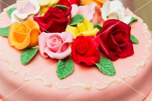 A celebratory cake decorated with roses