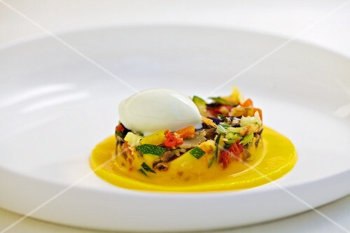 Colourful vegetables in pepper sauce with lemon balm ice cream