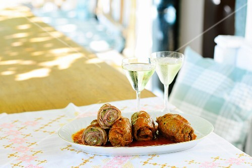 Rolled filled beef balls in sauce