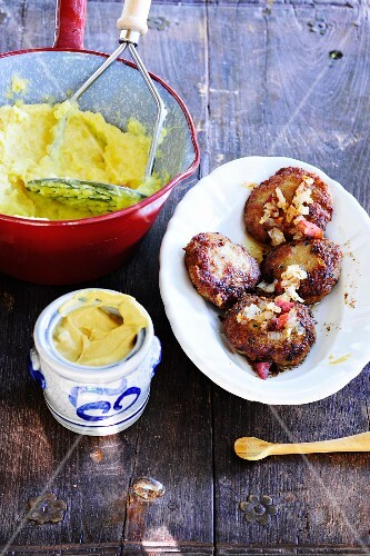 Meatballs with mashed potato and mustard