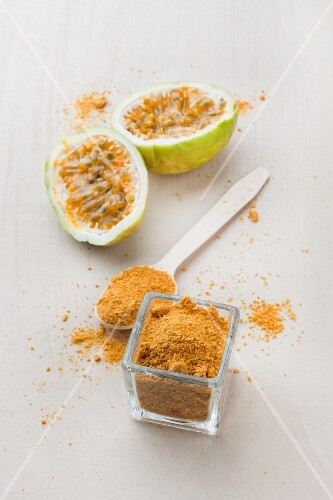 Passion fruit powder in a glass and on a spoon