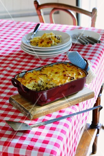 Gratinated pasta bake in an enamel baking dish