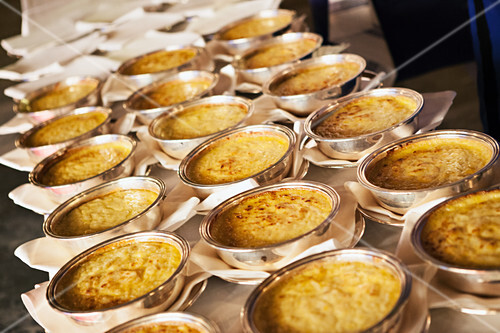 Gratinated mashed potatoes in silver dishes