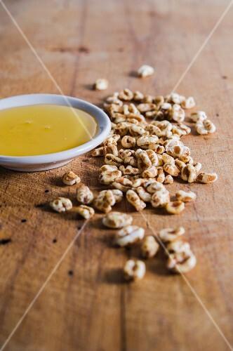 Honey puffed wheat next to a dish of honey
