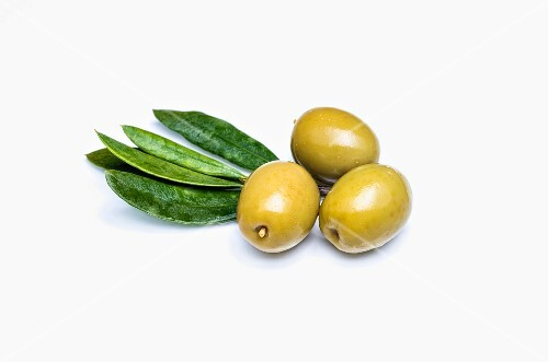 Three green olives on a white background