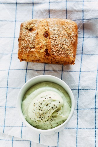 Avocado cream and a bread roll