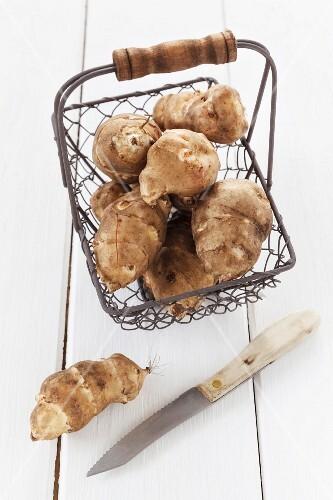 Jerusalem artichokes in a wire basket