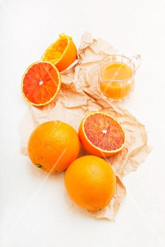 Sicilian half blood oranges: whole, halved and juiced