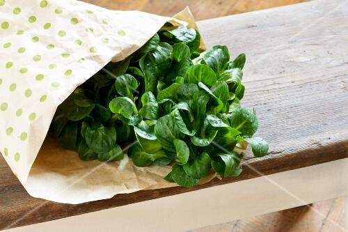 Fresh lamb's lettuce in a paper bag