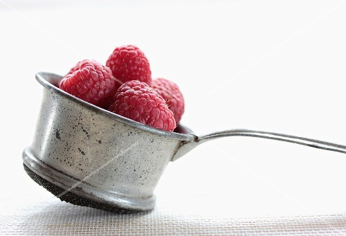 Raspberries in an old-fashioned sieve