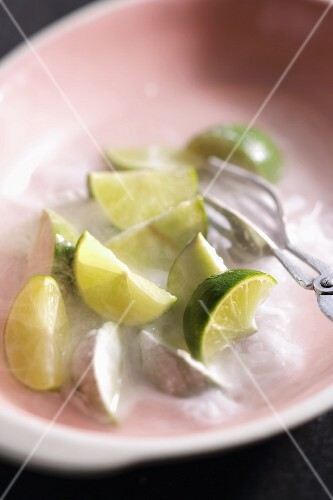 Lemon wedges on ice