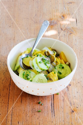 Potato salad with gherkins and cucumber