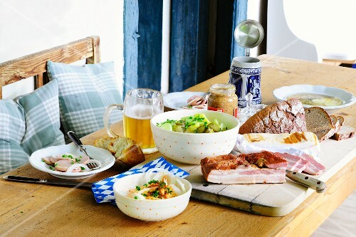 Barvarian supper with bacon, meat salad, potato salad and Obatzter cheese spread