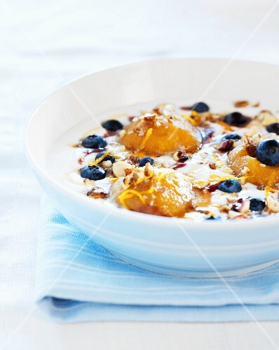 Yogurt dessert with blueberries, nuts and stewed apples