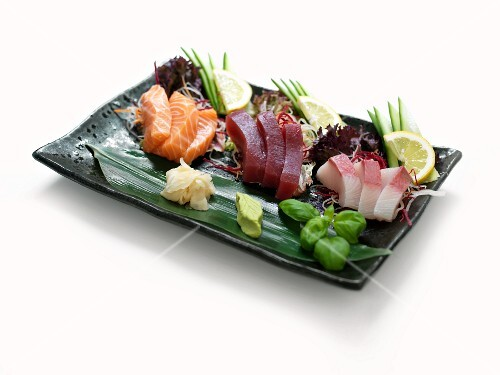 Raw fish with ginger and wasabi paste