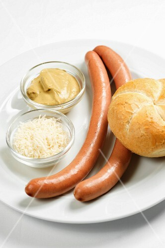 Hot dog sausages with horseradish, mustard and a bread roll