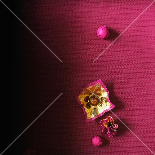 Chocolate pralines wrapped in gold foil