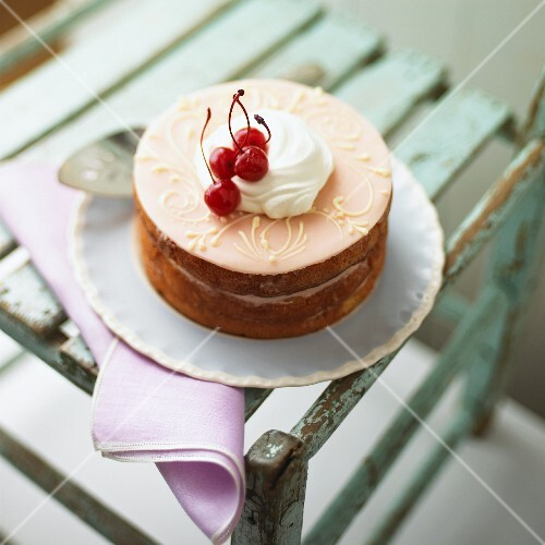 A marzipan cake with maraschino cherries and cream