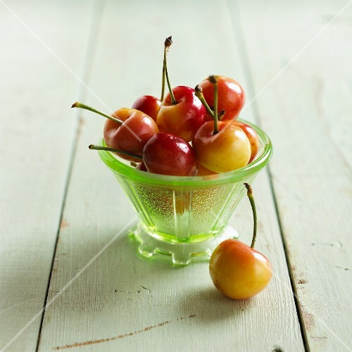Fresh sweet cherries in a glass bowl