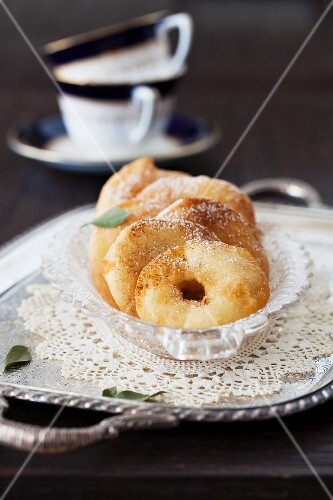 Apple fritters with cinnamon sugar (Italian carnival pastries)