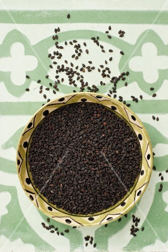 A bowl of black sesame seeds