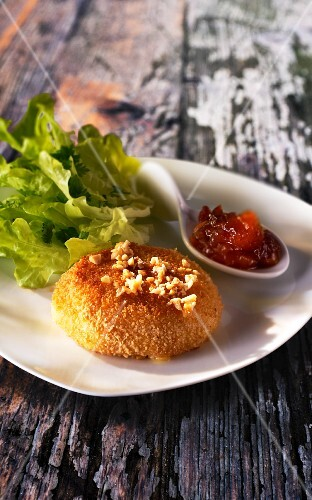 Baked bread cheese with mango chutney