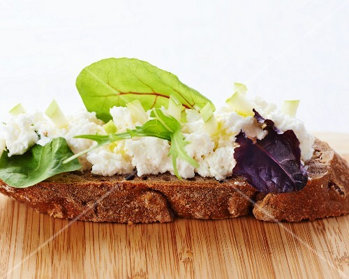 Soft cheese and herbs on bread