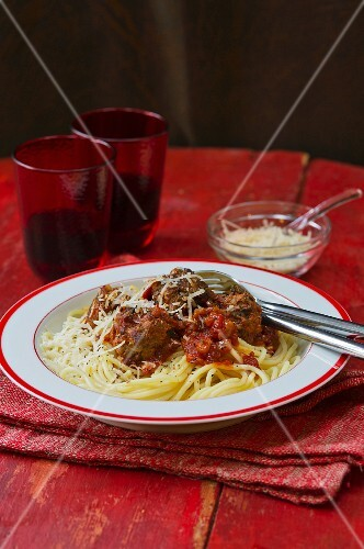 Spaghetti with meatballs, tomato sauce and Parmesan cheese
