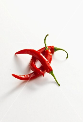 Three fresh red chilli peppers