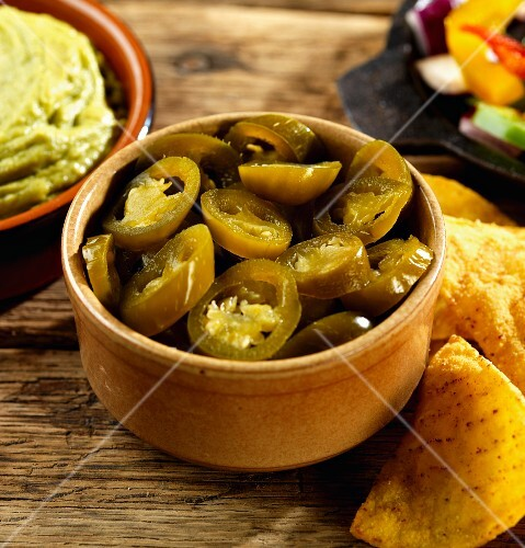 Pickled jalapeños, guacamole and tortilla chips (Mexico)