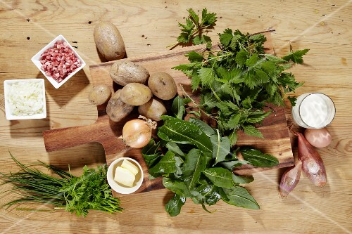 Ingredients for making potato cakes with stinging nettles and spinach