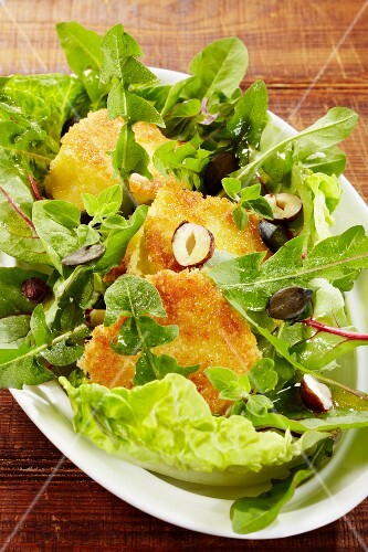 Dandelion salad with baked Camembert