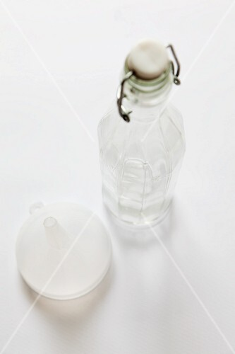 A glass bottle and a funnel