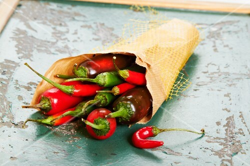 A paper bag of fresh chilli peppers