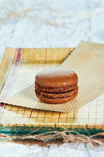 A chocolate macaroon on a tray