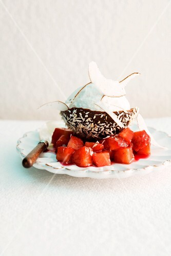 Coconut sorbet in a chocolate bowl with strawberry compote