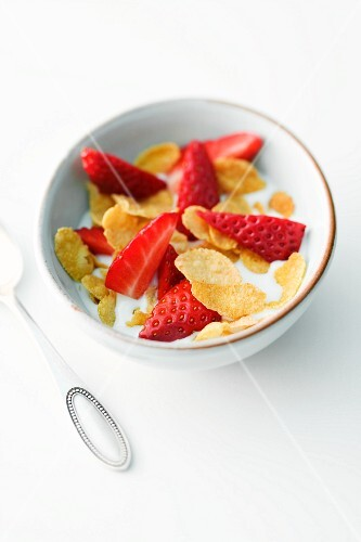 Bowl of Flake Cereal Topped with Fresh Strawberries