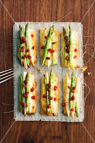 Asparagus tapas with chorizo and cheese