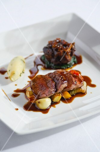 Lamb fillet and ossobuco with a side of vegetables