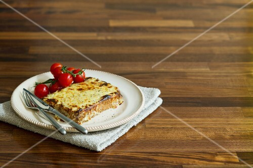 A Croque Monsieur with vine tomatoes