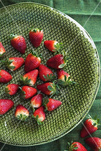 Strawberries on a green ceramic dish
