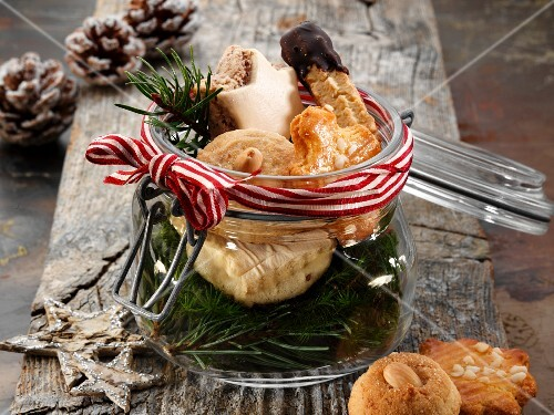 Various Christmas biscuits in a glass jar