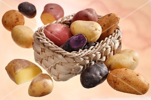 Various potatoes, some in a basket