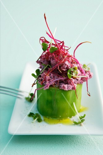 A cucumber filled with beetroot cream cheese