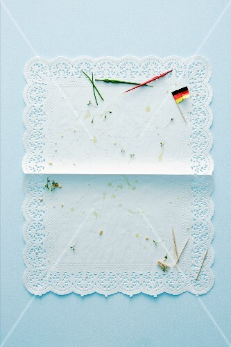 Crumbs from party snacks on a doily